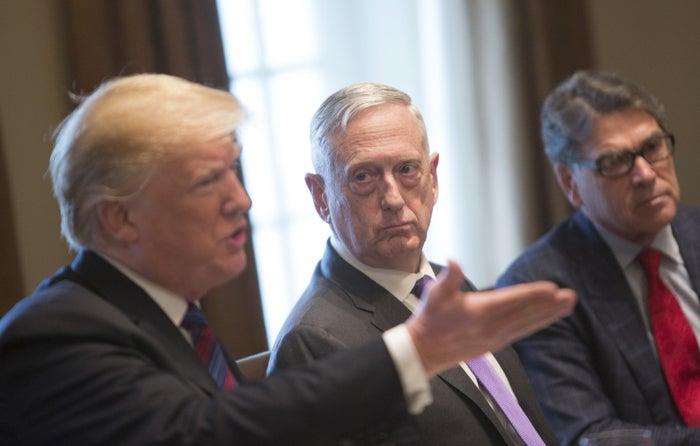 US Secretary of Defense James Mattis watches President Donald Trump speak.