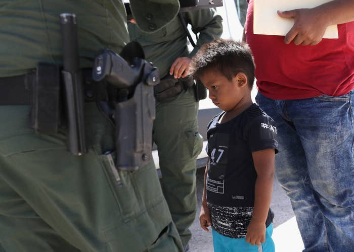 A boy and father from Honduras are taken into custody by US Border Patrol agents near the US–Mexico Border on June 12 near Mission, Texas.