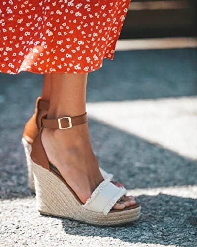 7f9d0b8463dc A pair of canvas and faux-leather espadrille wedges that ll help bring your  summer wardrobe (and you) to new heights.