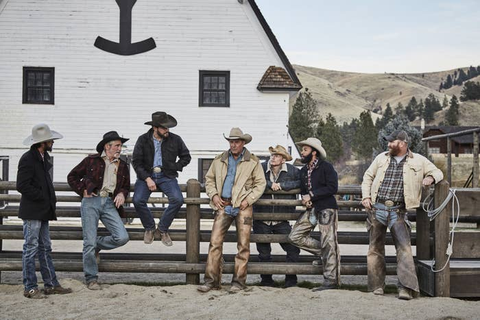 John Dutton (Kevin Costner), owner of the Dutton Ranch, surrounded by his ranch team Walker (Ryan Bingham), Lloyd (Forrie Smith), Rip Wheeler (Cole Hauser), Jimmy (Jefferson White), Colby (Denim Richards), and Fred (Luke Peckinpah).