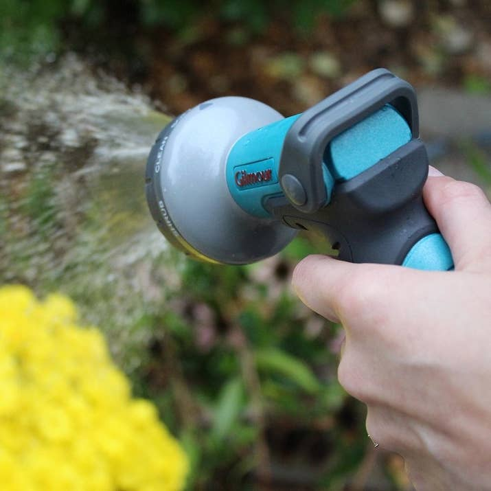 In your dream garden, you'd get almost two inches of rain in weekly afternoon showers, but we know that never happens. Read more on Gardening Know How, because it's a little more complicated than that; containers may even need daily waterings, depending on where you live. Get a highly-rated heavy-duty watering nozzle on Amazon for $15.99; it'll attach to your hose for easy watering.