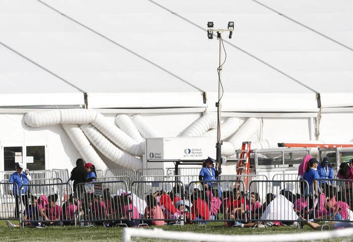 Immigrant children are shown outside of a former Job Corps site that now houses them in Homestead, Florida.