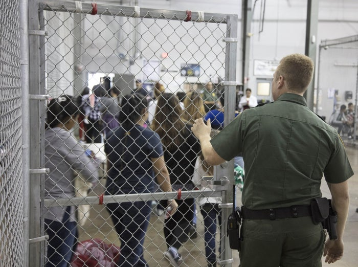 People who crossed the border illegally and were detained by US Border Patrol agents at the US Border Patrol Central Processing Center in McAllen, Texas, on June 17.