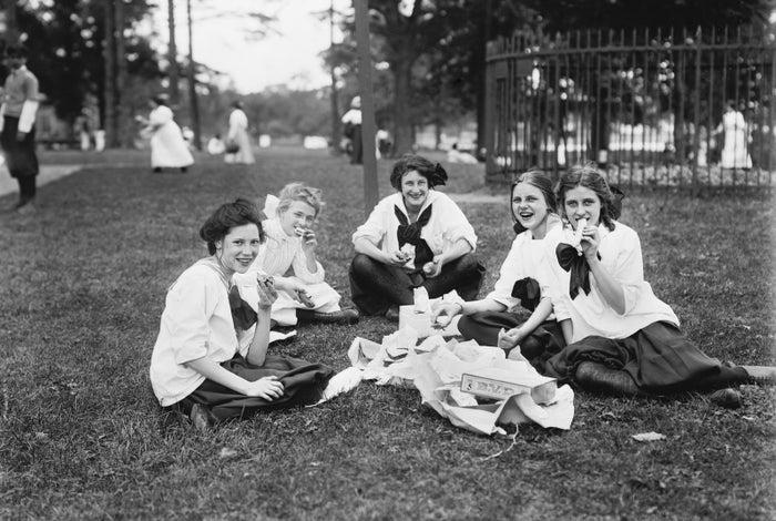 Teen girls have lunch during a midsummer festival.