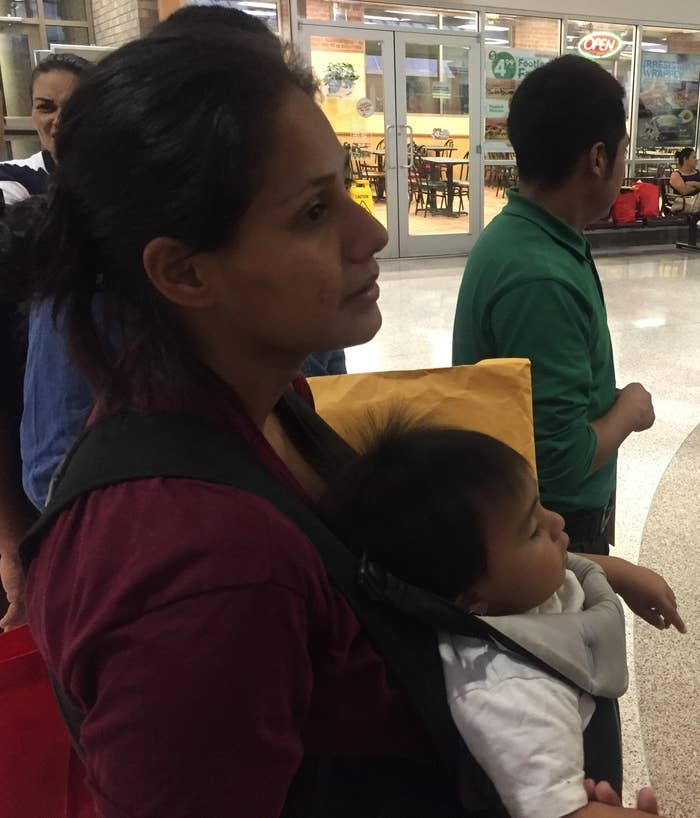 Maydi with her 11-month-old son at the McAllen bus station.