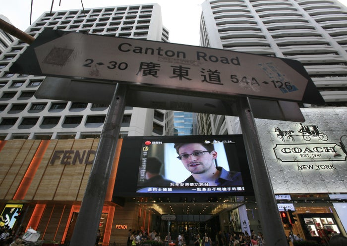 A news report on NSA whistleblower Edward Snowden, at a shopping mall in Hong Kong.