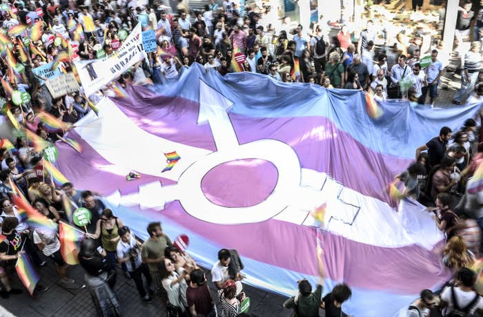 People hold a giant transgender flag during the Trans Pride March in Istanbul.