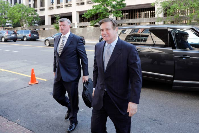 Paul Manafort (right) and his attorney Kevin Downing arrive at the federal courthouse in Washington, DC, on May 23.