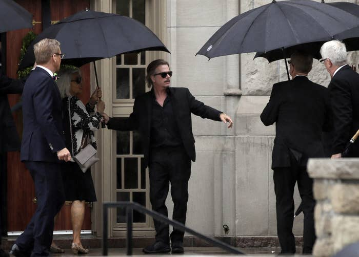 David Spade helps family members enter Our Lady of Perpetual Help Redemptorist Catholic Church for his sister-in-law's funeral in Kansas City, Missouri.