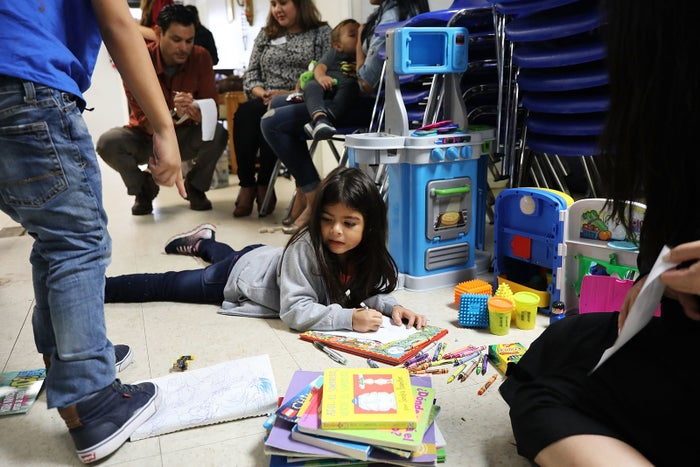 Recently arrived migrant families rest at the Catholic Charities Humanitarian Respite Center in McAllen, Texas.