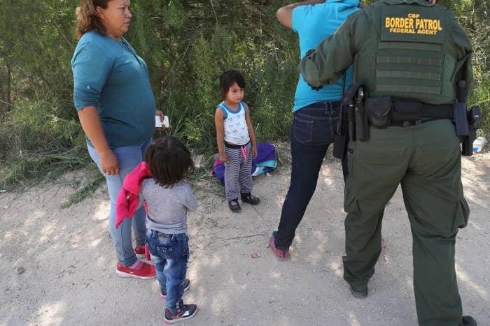 US authorities take Central American asylum-seekers into custody June 12 near McAllen, Texas.