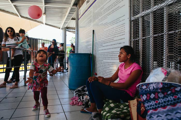 Romelia, 22, and her daughter, Aylin, 2, wait at the port of entry to file an asylum claim in Nogales.