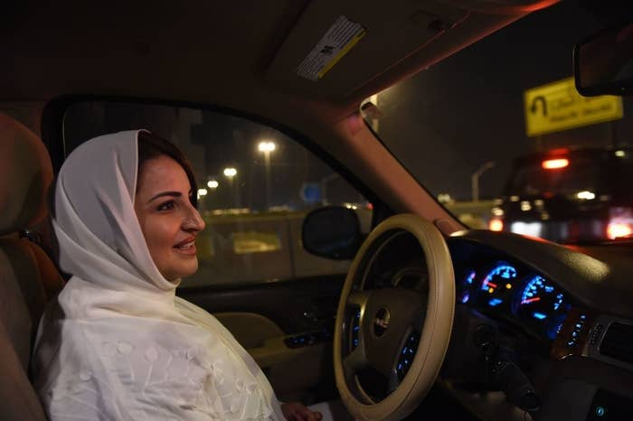 Saudi Samar Almogren drives her car through Riyadh's streets for the first time just after midnight, when the law allowing women to drive took effect in Riyadh, early 24 June.