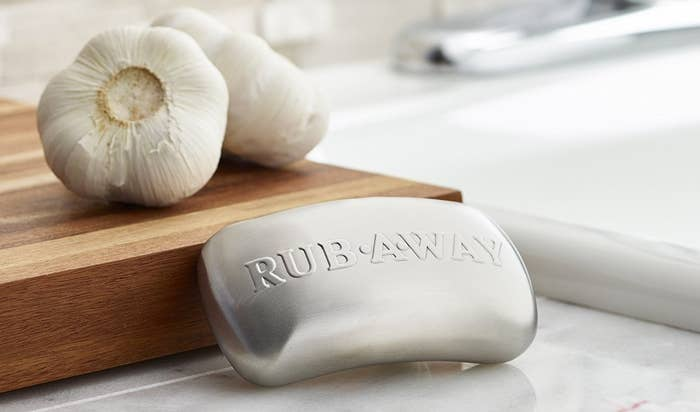 """The soap bar-shaped stainless steel, with the text """"rub away"""" on it"""