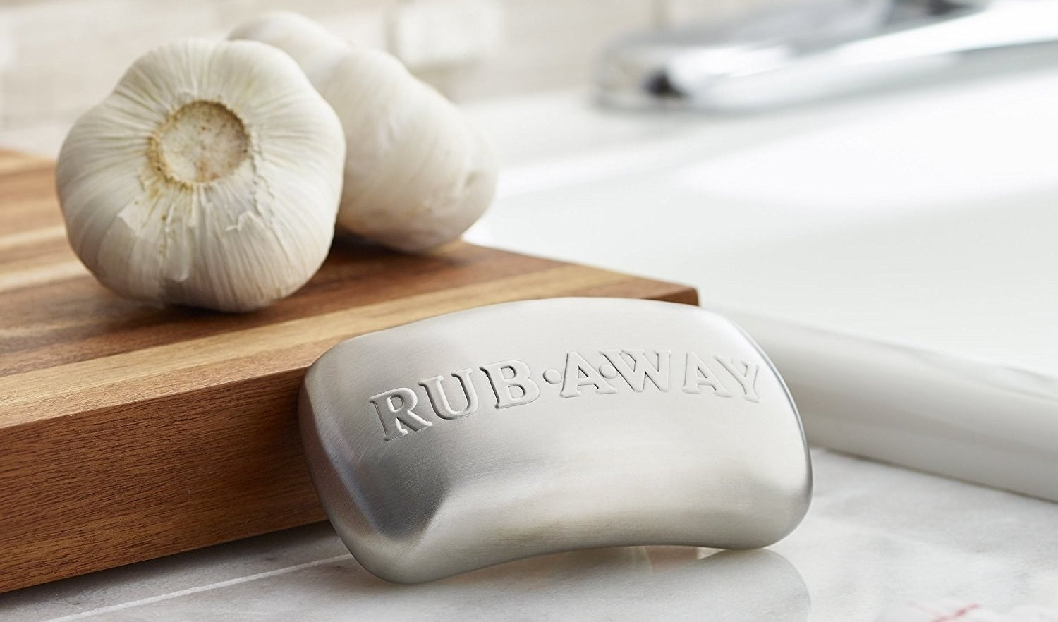"The soap bar-shaped stainless steel, with the text ""rub away"" on it"