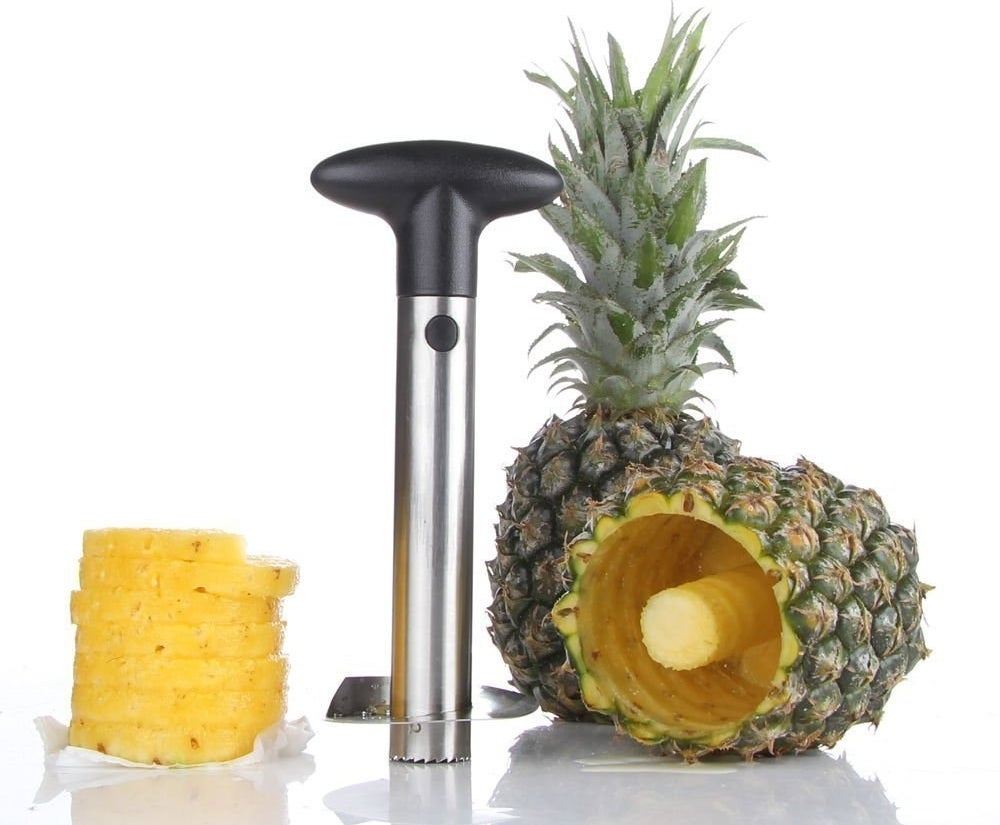 "Promising review: ""This thing is amazing. It works great! I prefer buying whole pineapples for a couple bucks (or even less on sale) vs. a much marked up price for the pre-cut stuff. However, it used to take me 20 mins to go through the whole process of cutting off all the inedible bits, even after watching multiple youtube videos on what was the 'best' way. I can now be completely done with the process in less than two minutes. Cut off the top, drill, and extract. That's it! I'm more than happy to sacrifice just a bit of usable fruit in trade for a 10x time savings!"" —CSGet it from Amazon for $7.99 or a similar one from Walmart for $6.68."