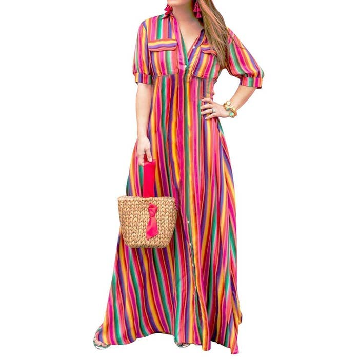 """Promising review: """"Love this dress. Cute as a button and bright!! It is fitted in the bodice, so if you are broad-shouldered and/or large-chested, order up!! I am 5'6"""" and normally wear a 14 — I ordered a 3XL. Perfect length does not drag on the floor. I can wear with flats and sandals. But it runs smaller in shoulders and chest. If I button up into the chest area (as most would normally wear), I will need to put a snap in between one button so it won't gap and show my bra. Or wear a camisole or colored tank under and leave that one button undone. I love this dress, with or without the belt. I was very pleased."""" —Jay & GlendaPrice: $28.99 (available in sizes S-3XL and in black, blue, purple, and red)"""