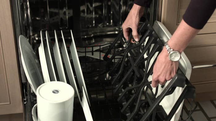 It's way too hard to scrub those things by hand! Just make sure the grates are enamel-coated before you try this trick. Learn more here.