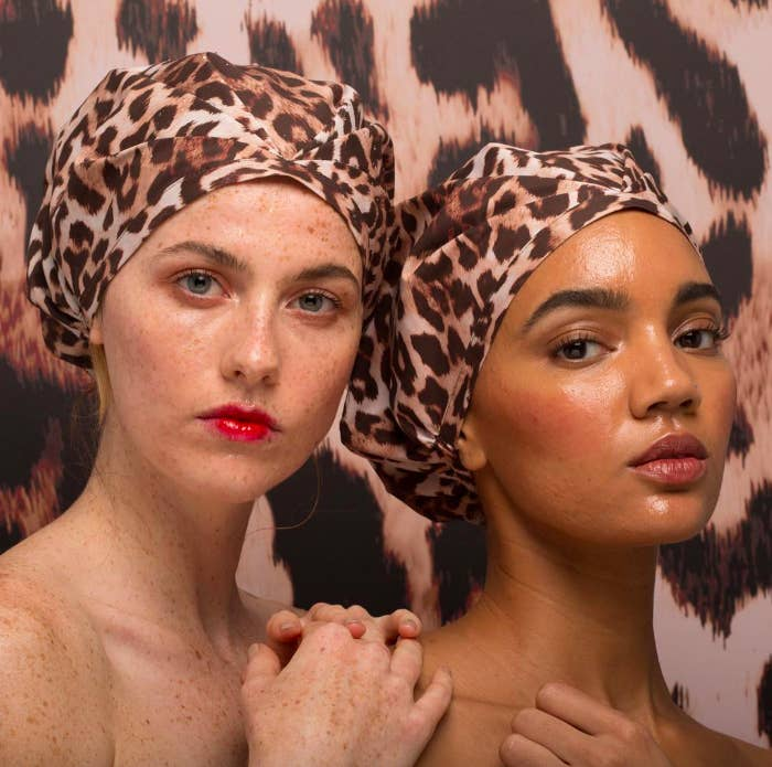 """Promising review: """"For years I have been putting my hair in a bun and a thick headband while avoiding the shower with expert practice to avoid wetting my hair. I stumbled upon this and thought, now there's a shower cap I could live with! It is so pretty, the box was so nice also. A great gift! No lines on my face or soreness from a tight band! The print is lovely, the fabric is completely water proof and shakes off easy. I am going to use it with a hair treatment today!"""" —karenjoanCheck out why a BuzzFeeder swears by it. Get it from Sephora for $43 (11 patterns) or Revolve for $43 (four patterns).Want less of a splurge? Get a Kitsch Luxe shower cap from Amazon for $24+ (four patterns)."""