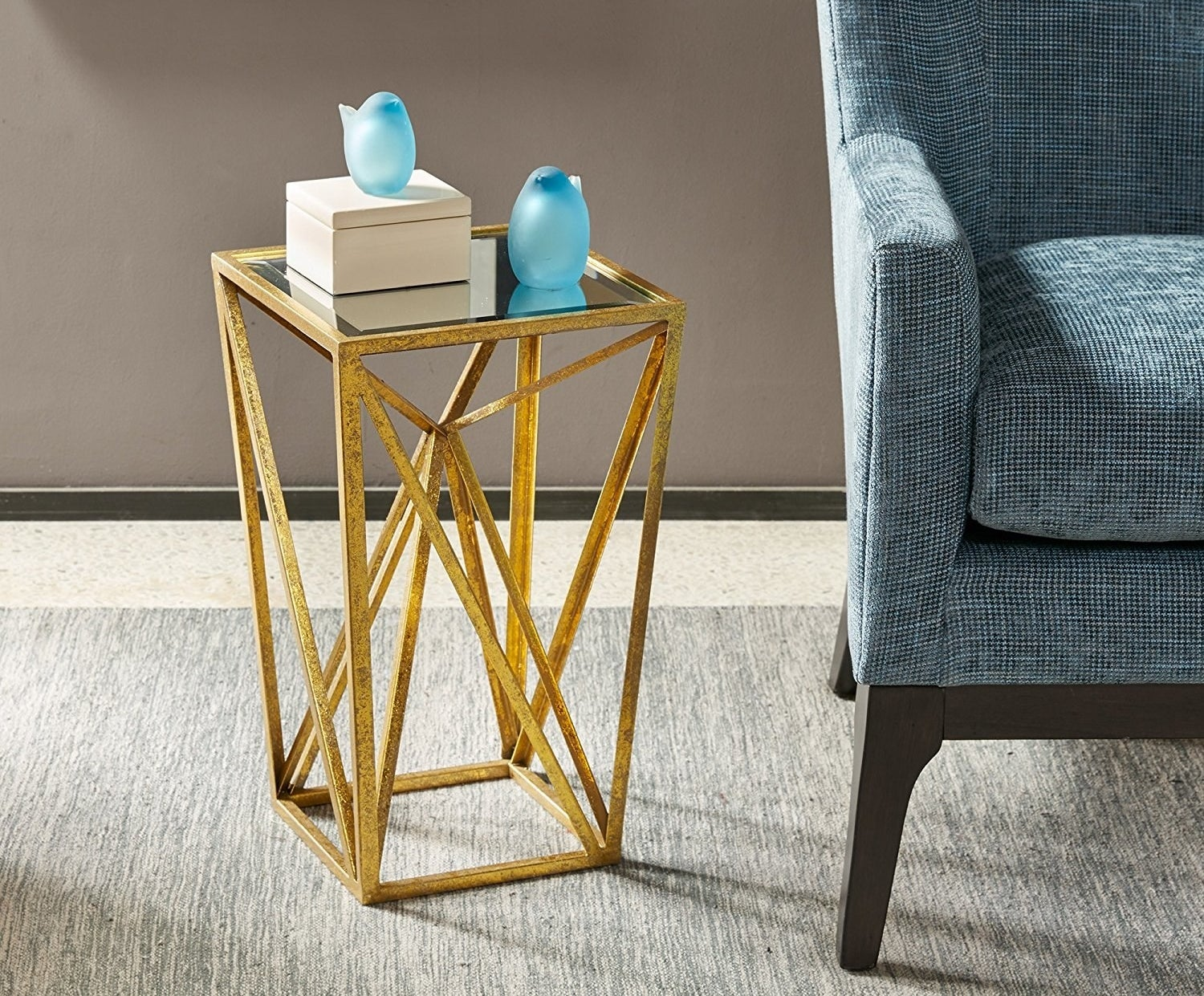 """Promising review: """"The gold has a glam look to it, and the mirror on top is beautiful. It is super lightweight and easy to move, but sturdy enough to be able to hold a lamp or vase."""" —JessicalynnGet it from Amazon for $68.72+ (available in two colors)."""