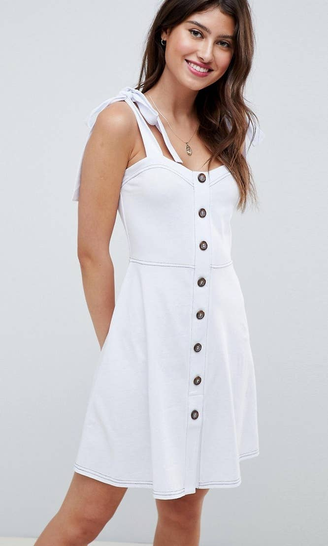 d1e52472247da3 A tie-shoulder pinafore dress you ll want to throw on over your bikini for  romantic strolls on the boardwalk.