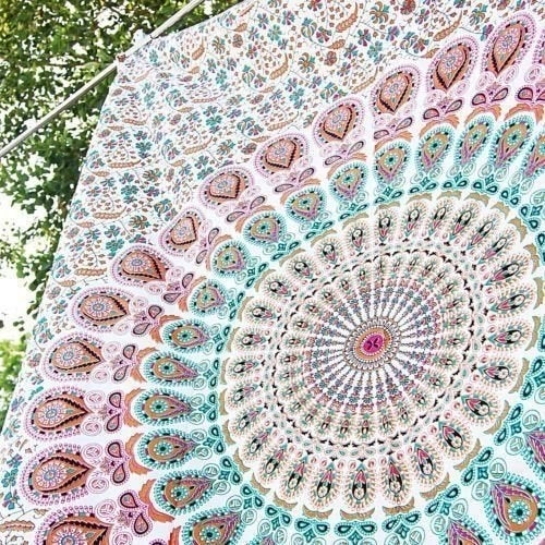 """Promising review: """"This is such a pretty tapestry. I used it all summer on the beach and it held up really well and looked really pretty. The colors are so soft and beautiful."""" —RJGet it from Amazon for $7.38."""