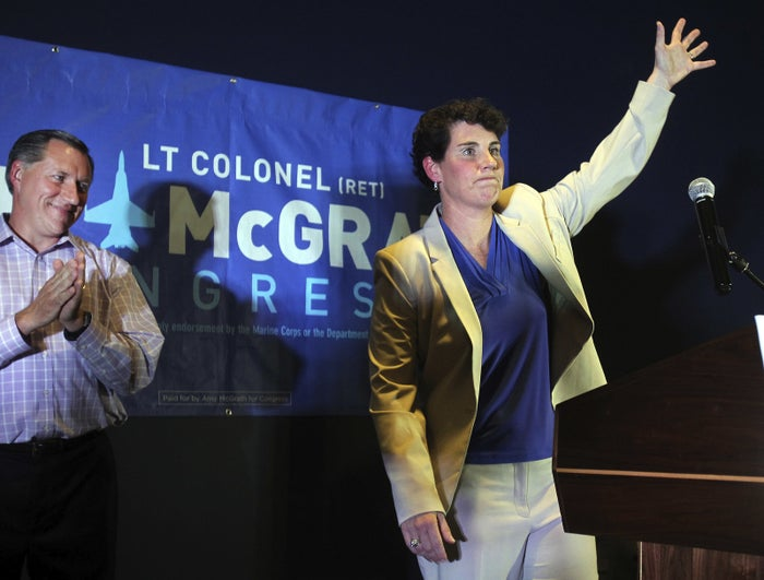 Amy McGrath waves to supporters after being elected as the Democratic candidate for Kentucky's 6th Congressional District.