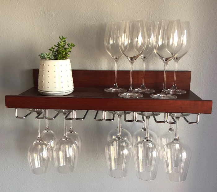 "This is an easy way to keep your ~fancy~ glasses in sight, but not in your damn way. Promising review: ""This rack mounted easily, and holds 18 stems without trouble! This is the perfect way to have glasses handy."" —K. GovocekGet it from Amazon for $8.69."
