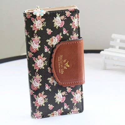 cf9c0a3fffd A pretty floral wallet that can totally double as a clutch because you can  stash all your essentials in it.