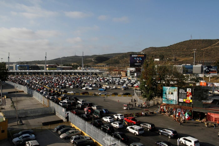 Cars wait to be inspected by US Border Patrol officers before they enter the US from Tijuana, Mexico, on April 4.