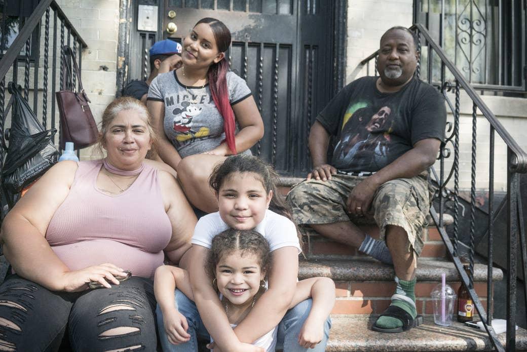 Migdalia Lugo, 44, (left) her nieces (center), and her husband (right).