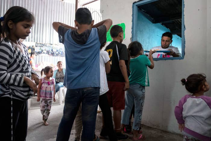 Asylum seeking children from Mexico and Central America line up for breakfast at a migrant shelter in Tijuana, Mexico.