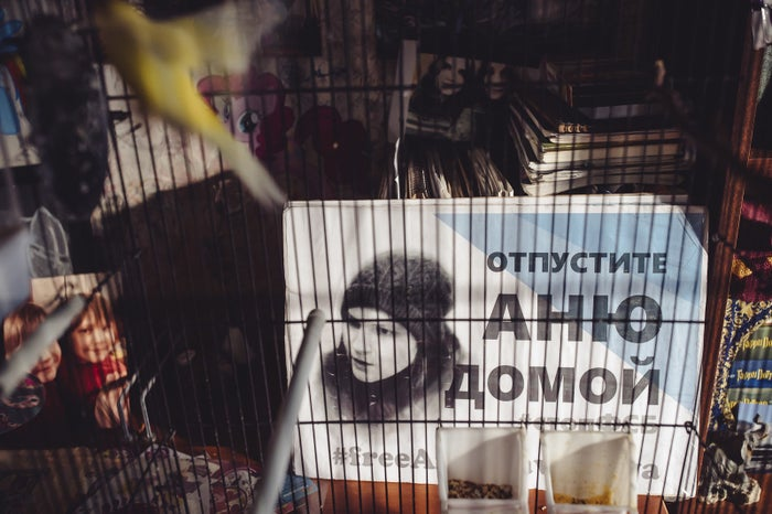 A poster showing Anna Pavlikova behind the cage of the parakeets she used to breed.