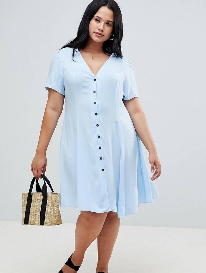 454de640ba0 A v-neck tea dress you can easily wear while drinking tea  whether you re  at a casual hang or a fancy tea party