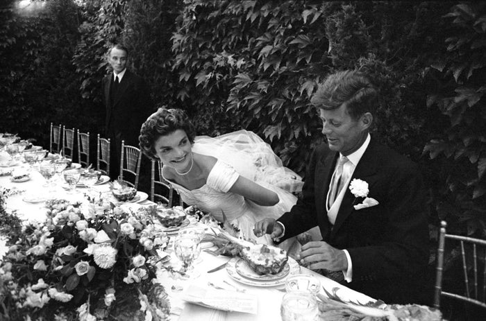 Newlyweds Jacqueline and John Kennedy take their seats at their wedding reception on Sept. 12, 1953, in Newport, Rhode Island.