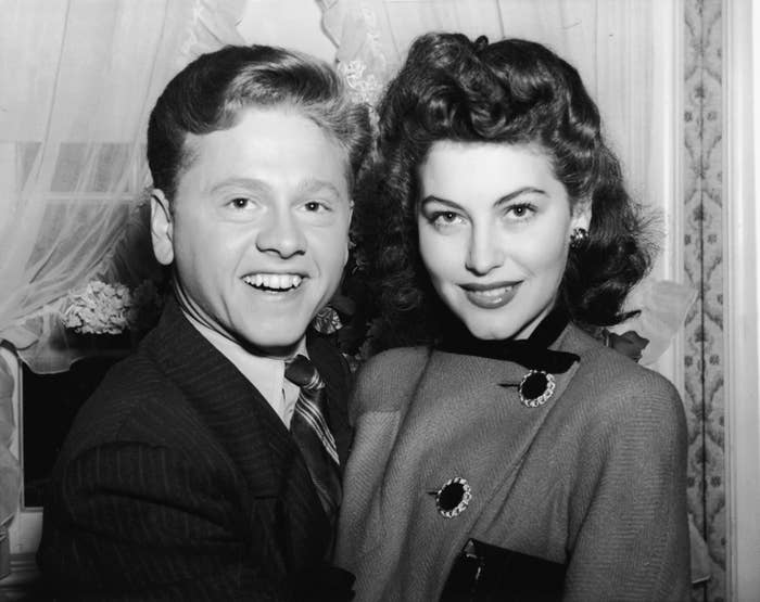 """A 19-year-old actress-on-the-rise at the time, Gardner was the first of Rooney's eight marriages. Wearing a suit instead of a wedding gown was popular in the '40s, and TBH, Gardner's face does say, """"I'm a trendsetter and I know it."""""""