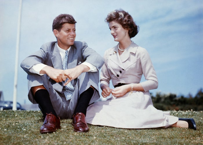Then-senator John F. Kennedy and Jacqueline Bouvier sit together at the Kennedy family home in Hyannis Port, Massachusetts, a few months before their wedding, on June 27, 1953.