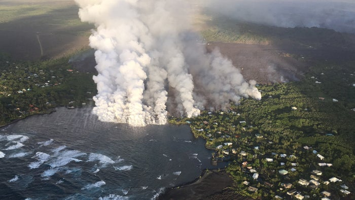 Lava is seen flowing into the ocean on Monday morning.