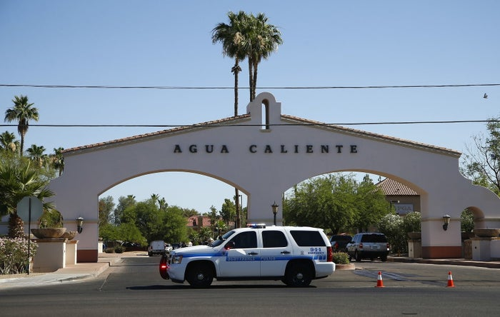 Police block off and surround a hotel where a suspect wanted in several killings was staying on June 4, 2018, in Scottsdale, Arizona.