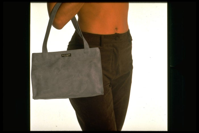 A model carries a faux suede handbag by Kate Spade on Aug. 1, 1996.