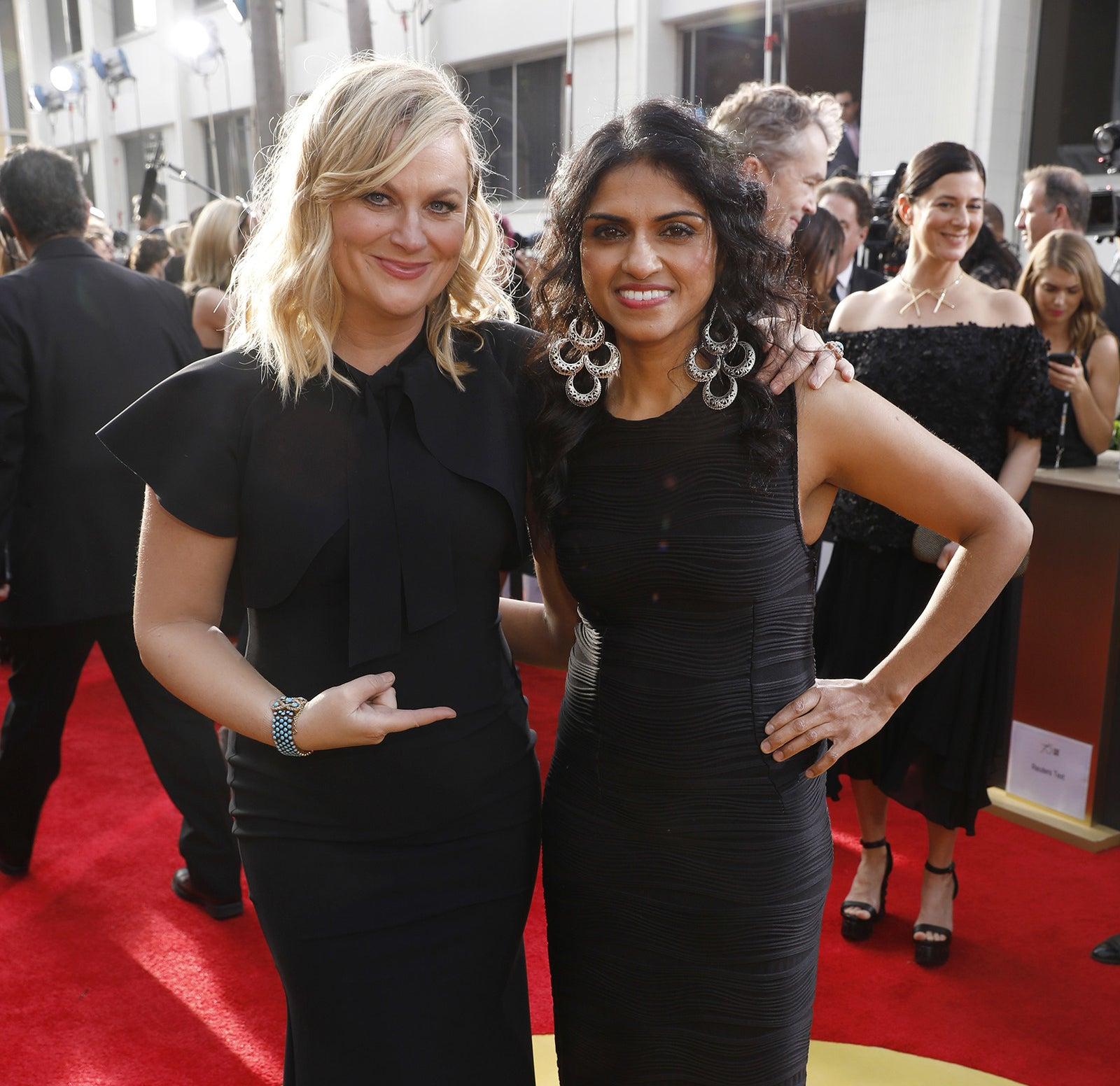 Amy Poehler and Saru Jayaraman at the Golden Globe Awards in January 2018.