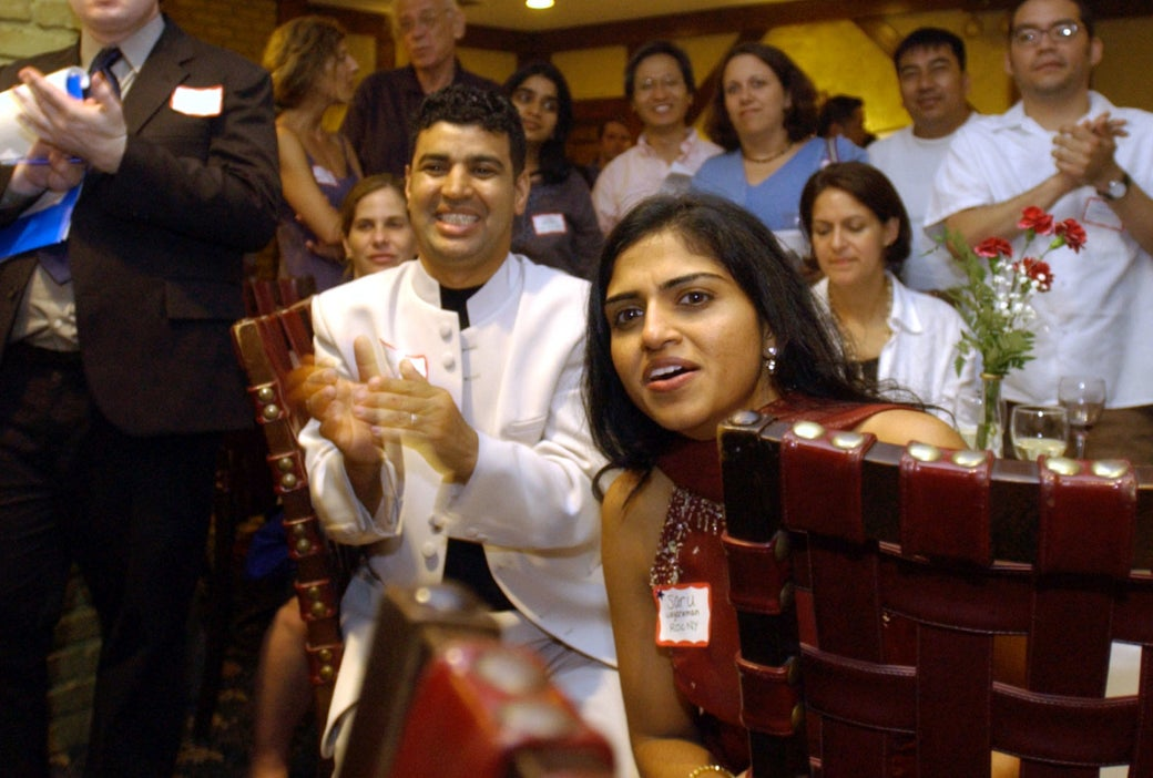 Fekkak Mamdouh (left) and Saru Jayaraman at an exhibition of photographs by surviving workers of Windows on the World restaurant in New York, July 9, 2003.