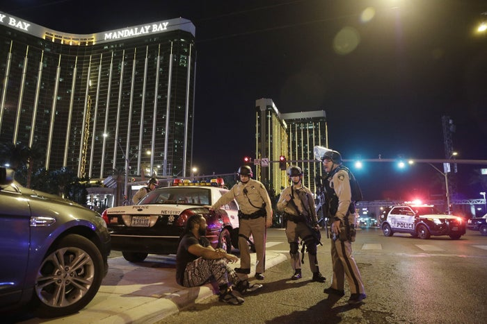 Police officers stand at the scene of the shooting near the Mandalay Bay resort and casino on the Las Vegas Strip, Sunday, Oct. 1, 2017.