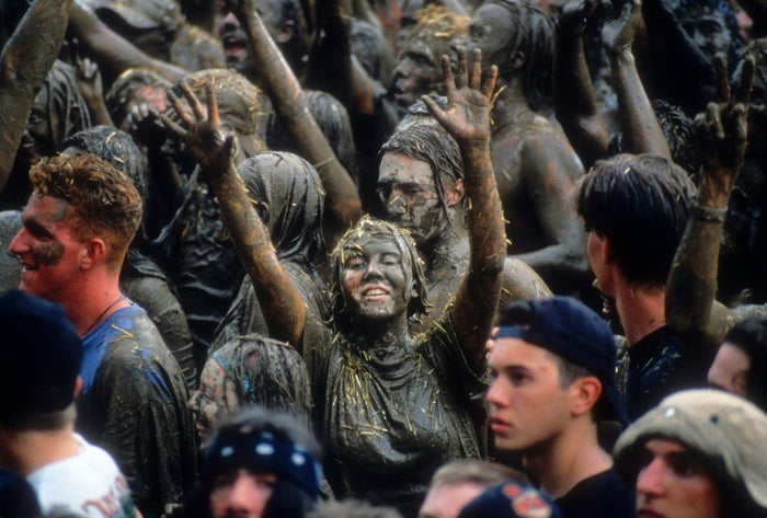 Concertgoers are covered in mud at the Woodstock '94 music festival in Saugerties, New York.