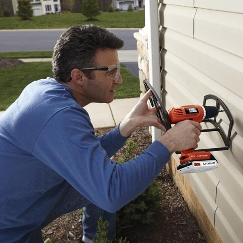 model drilling into an outdoor wall