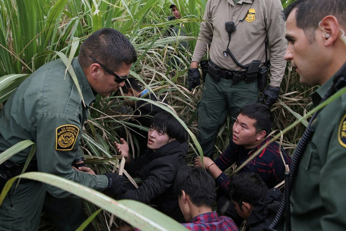 Border patrol agents apprehend immigrants who illegally crossed the border from Mexico into the US.