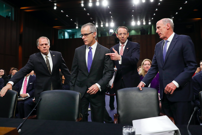 James Wolfe (left) helps direct acting FBI Director Andrew McCabe (second left), Deputy Attorney General Rod Rosenstein, and National Intelligence Director Dan Coats to their seats for a Senate Intelligence Committee hearing on June 7, 2017.