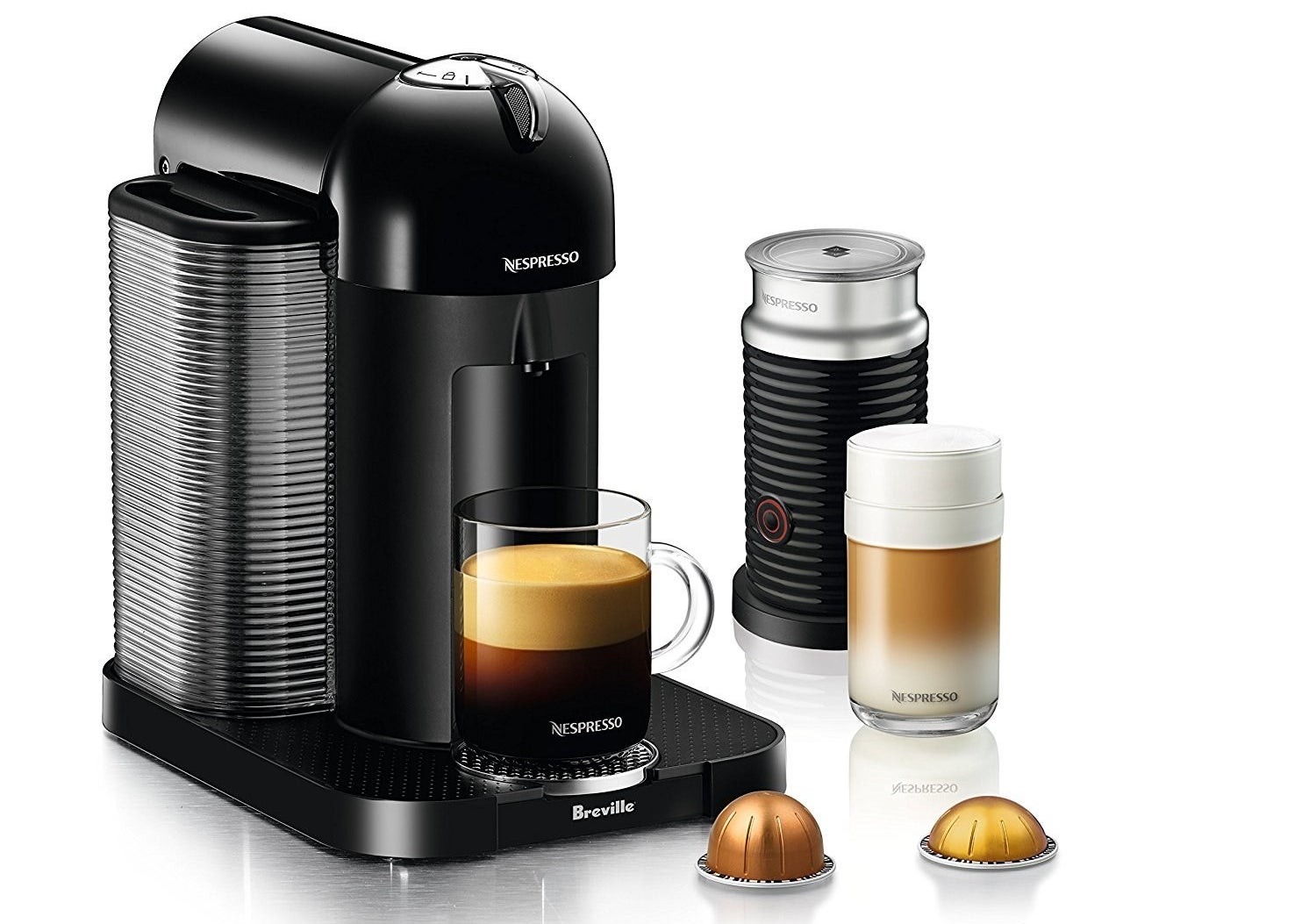 The machine, plus two Nespresso pods and the aeroccino milk frother