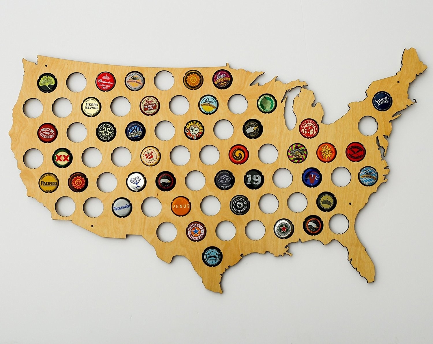 wooden united states map covered in holes for bottle caps