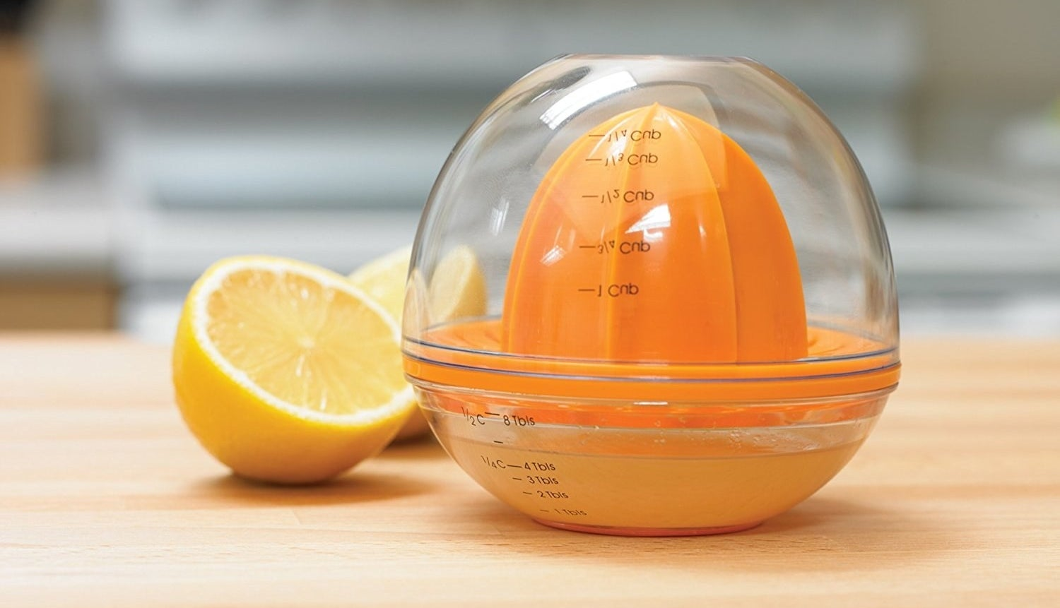 The clear and orange juicer